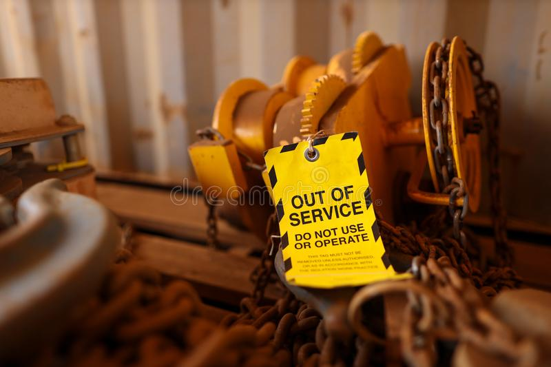 Out of service tag attached on faulty defect lifting beam trolley stock images