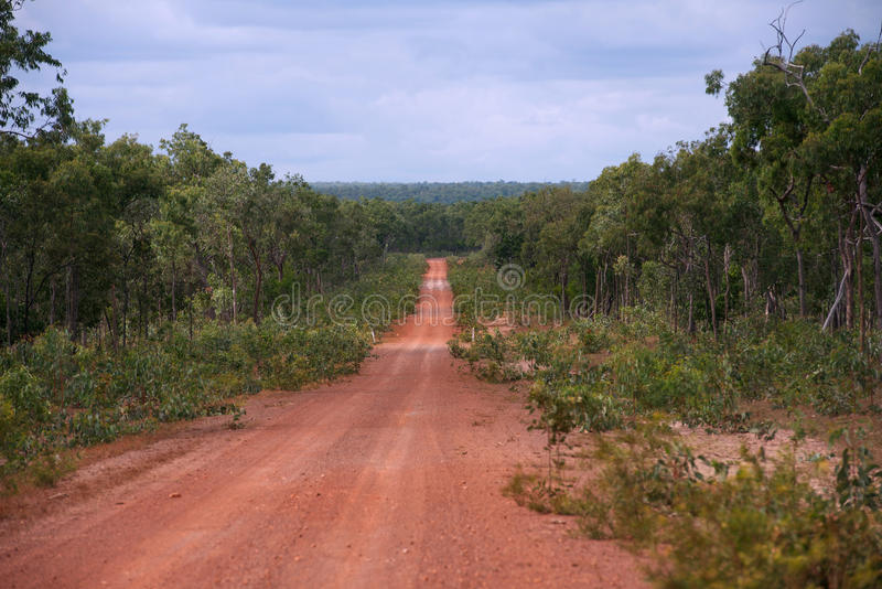 Outback road. Long straight dirt outback track in the remote Australian countryside, Cape York Peninsula, Far North Queensland, Australia stock image