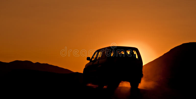 Outback SUV. SUV during sunset on hilli terrain stock photos