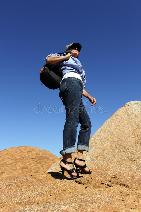Outback Woman Walking in High Heels royalty free stock photos