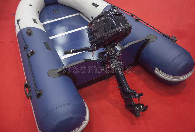 Outboard boat engine. Small capacity outboard engine attached to an inflatable rubber boat royalty free stock photos
