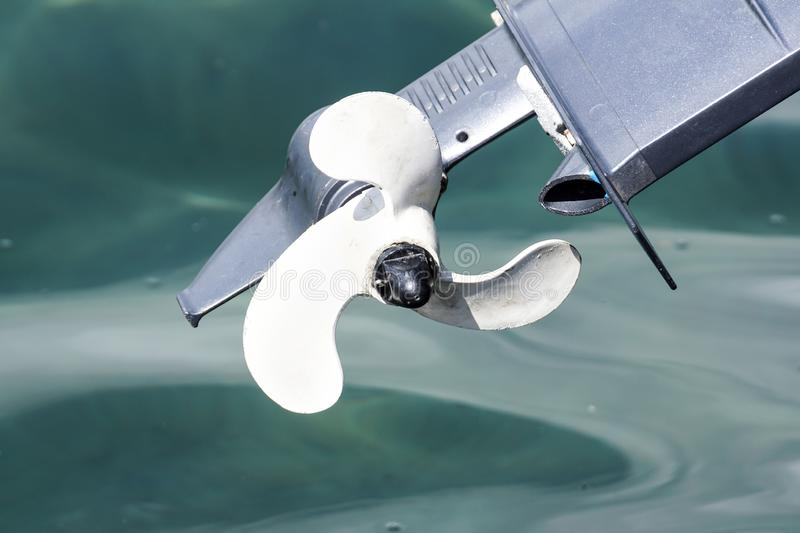 Outboard engine propeller on the sea.  royalty free stock photo