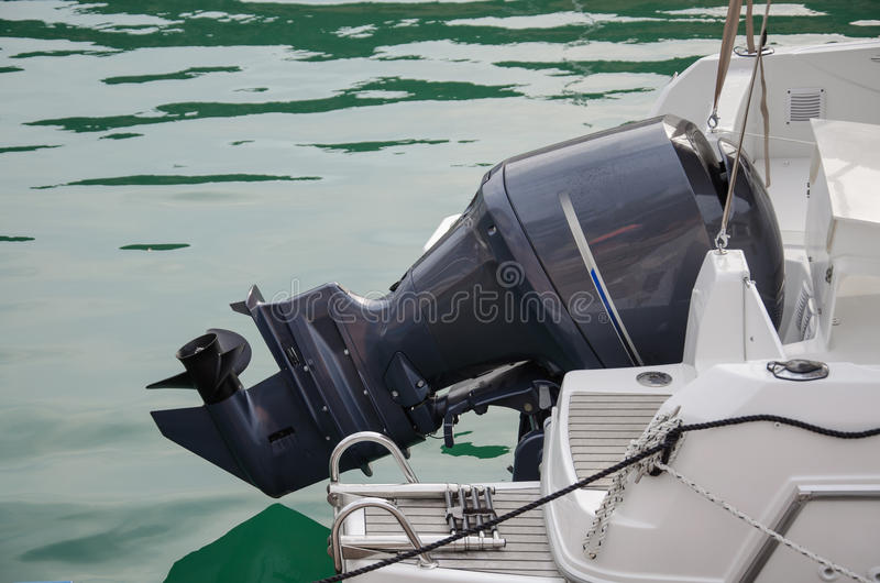 Outboard motor. On the white yacht royalty free stock image