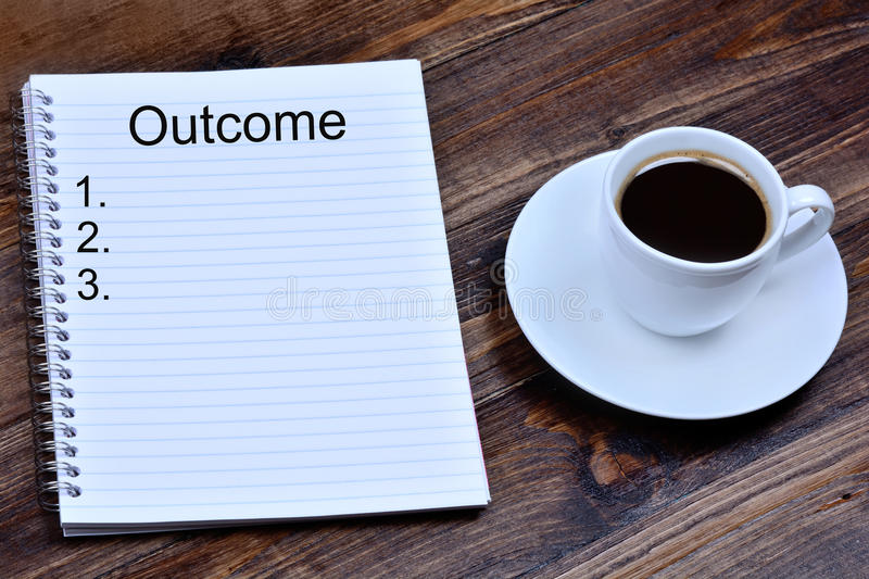 Outcome word on notebook royalty free stock images