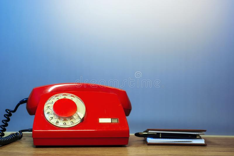 Outdated red rotary dial telephone royalty free stock photo