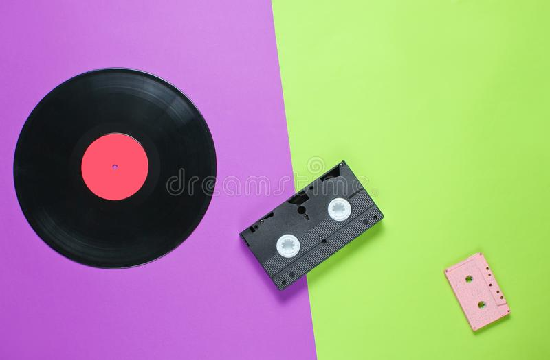 Outdated video cassette, retro audio cassette, vinyl record stock images