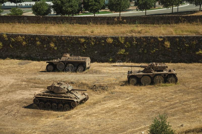 Outdated war tanks in the moat next to the wall of Elvas stock photos