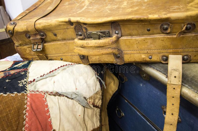 Outdated Worn Vintage Pile Of Luggage royalty free stock image