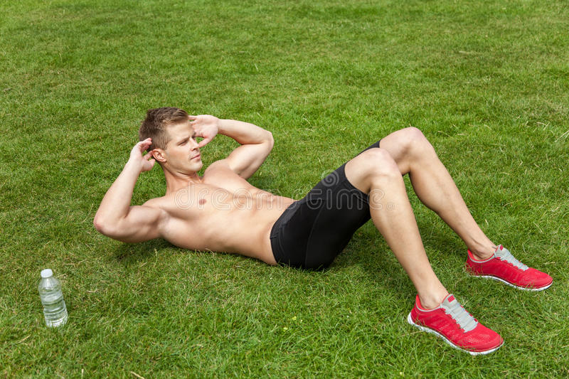 Outdoor abs excercise stock photo