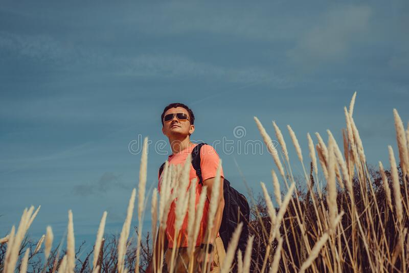 Outdoor Adventure. Traveler with backpack explore world. Man freedom travel. Backpacker holiday. Active lifestyle. Poland Europe. Vacation. Discovery ecotourism stock image