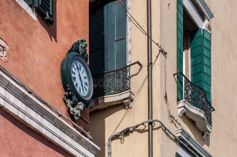 Outdoor analog wall street clock in Venice, Italy.  stock image