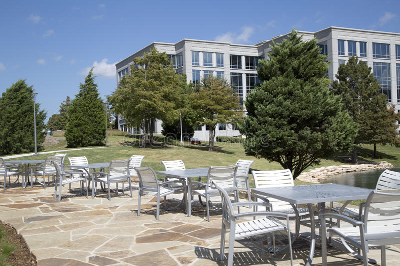 Outdoor architecture , tables and chairs. Beautiful outdoor architecture in the park design, Hall park Frisco TX USA royalty free stock photo