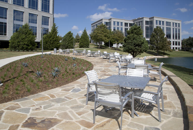 Outdoor architecture with tables and chairs view. Beautiful outdoor architecture in the park design, Frisco Hall park TX USA royalty free stock image