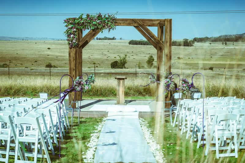 Outdoor Autumn wedding on brown grass stock images