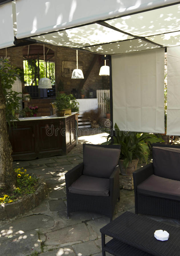 Outdoor bar corner on a restaurant. FLORENCE, ITALY - MAY 21 2016: Outdoor bar corner on a restaurant on the Florentine hills, nobody around royalty free stock image
