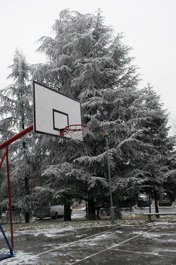 Outdoor basketball court on the cold winter day royalty free stock photos