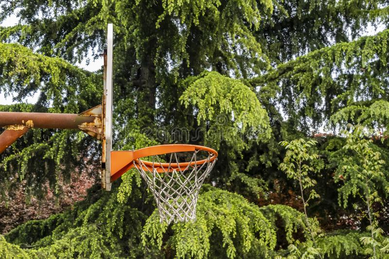 Outdoor basketball hoop to play basketball in public park. In nature stock photo