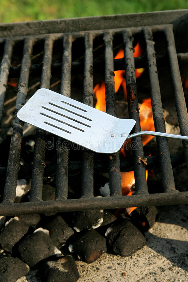 Outdoor bbq pit. Charcoal on fire heating up a barbecue pit before cooking stock photos