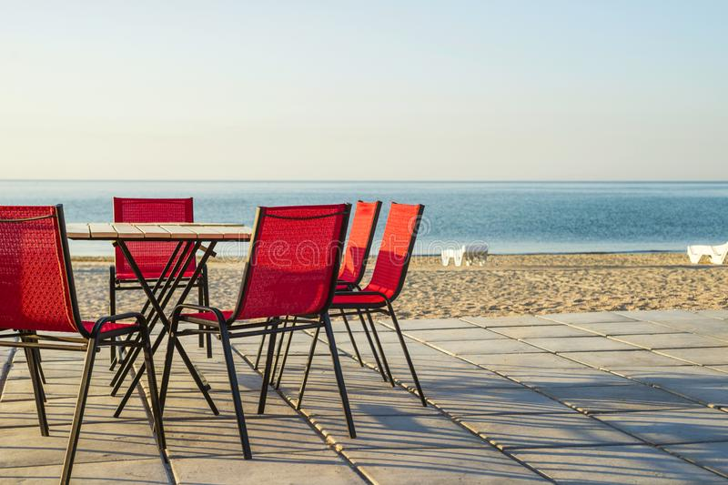 Outdoor beach restaurant at tropical resort.Tables and chairs in a cafe on the beach stock photo