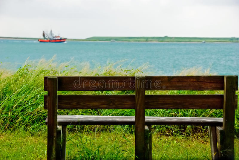 Outdoor bench with harbor view royalty free stock photo