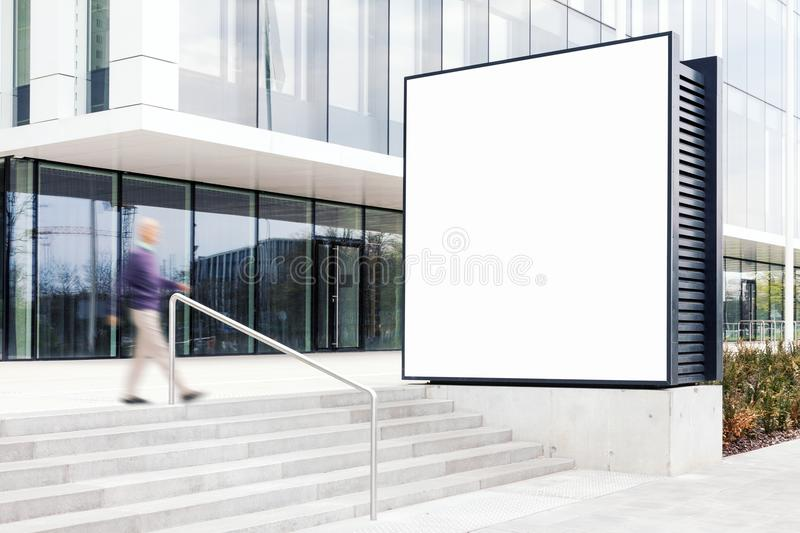 Outdoor billboard mockup in modern business district stock images