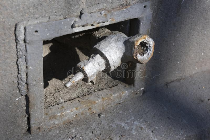 Outdoor broken water supply pipe stock photos