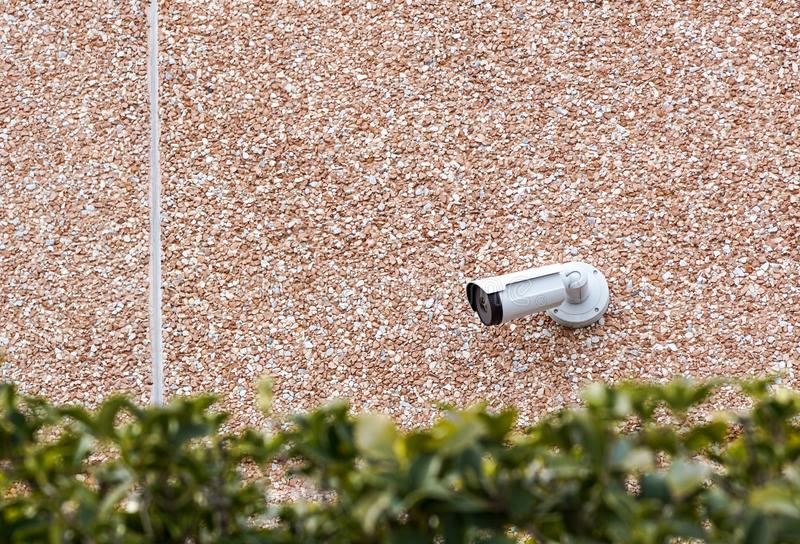 Outdoor bullet CCTV camera on the wall, space for text. Concept - technology and security.  stock photo