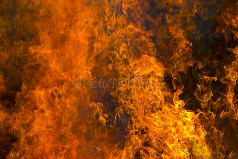 Outdoor burning fire and open flame. Black-orange background stock images