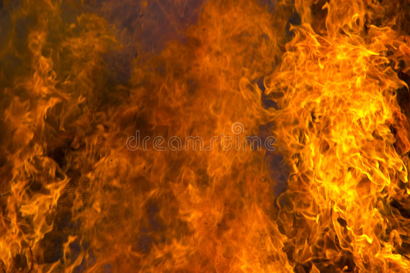 Outdoor burning fire and open flame. Black-orange background stock photo