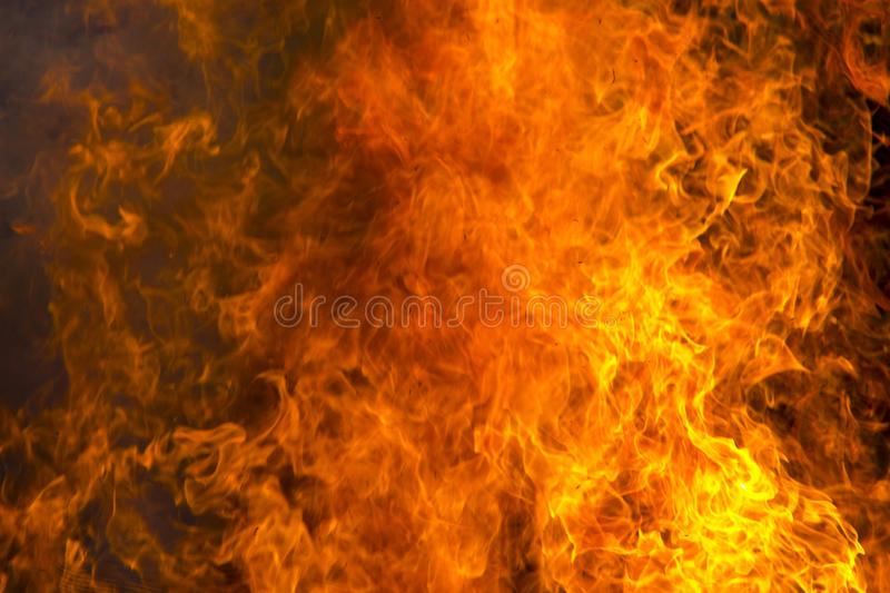 Outdoor burning fire and open flame. Black-orange background stock photography