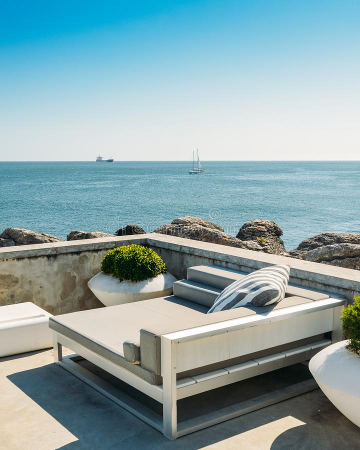 Outdoor cabana beds on a rooftop overlooking a tropical ocean royalty free stock images