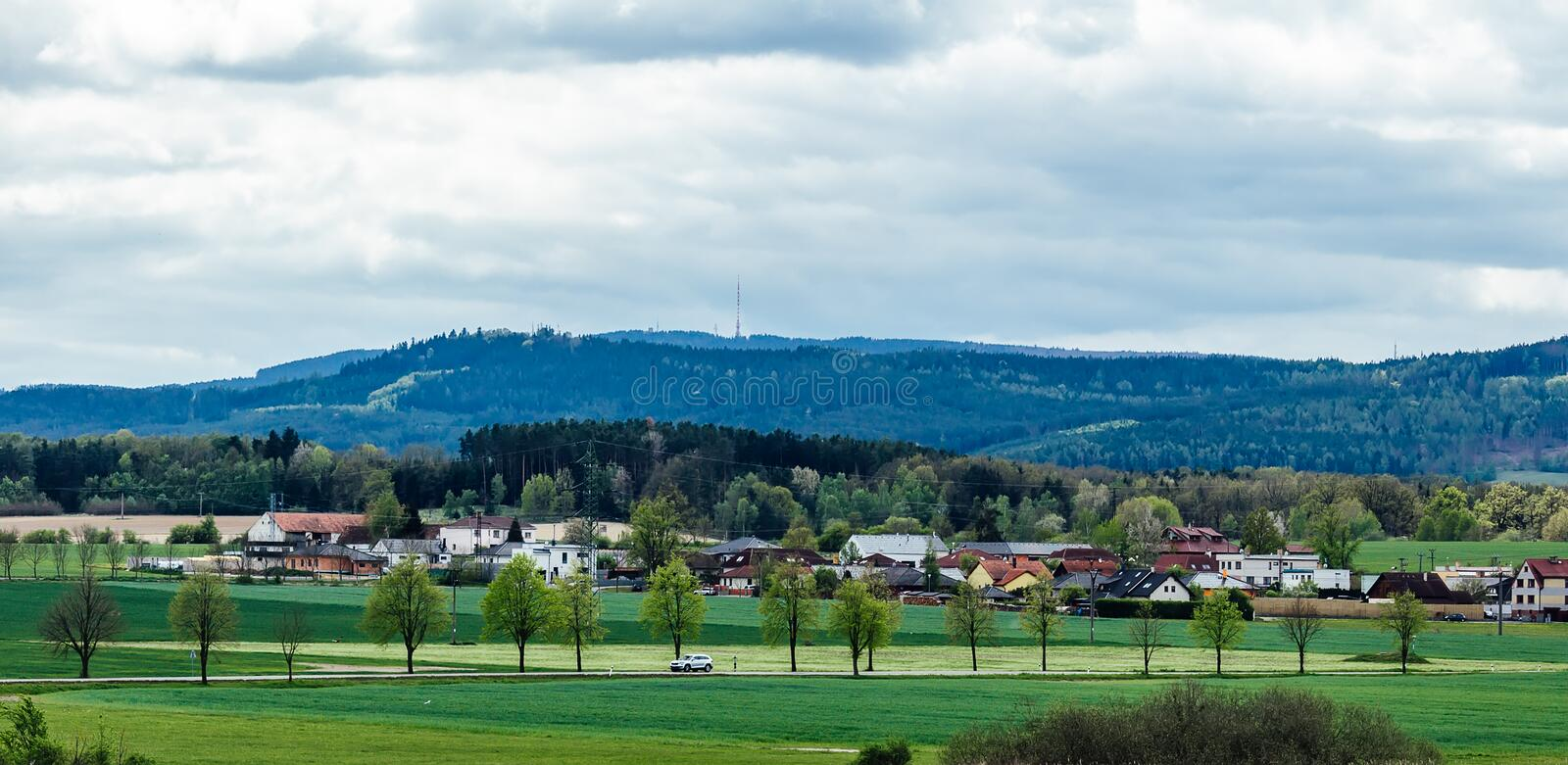 Outdoor car ride on spring czech landscape with hill Klet.  royalty free stock image