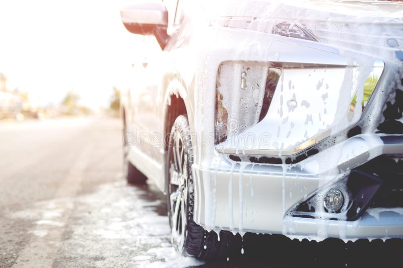 Outdoor car wash with active foam soap. commercial cleaning washing royalty free stock images