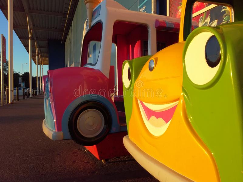 Outdoor cartoon play cars. In the sunset light stock photo