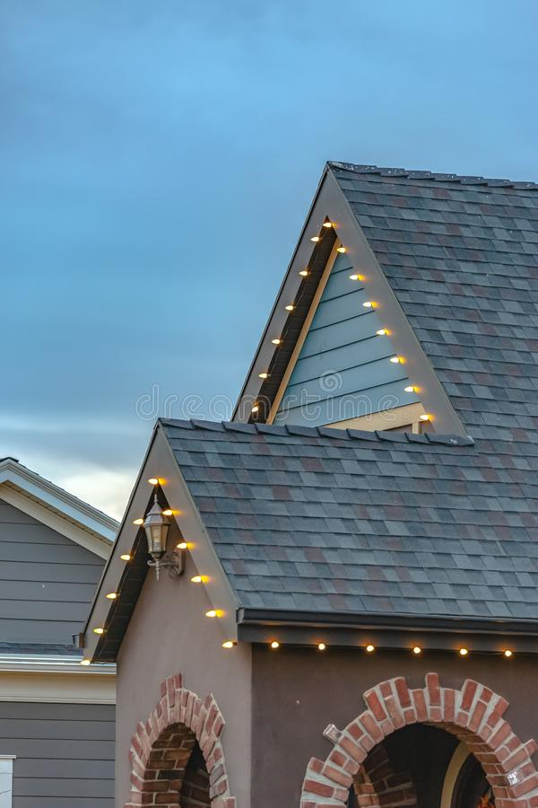 Outdoor Christmas lights on the roof of a home royalty free stock photos