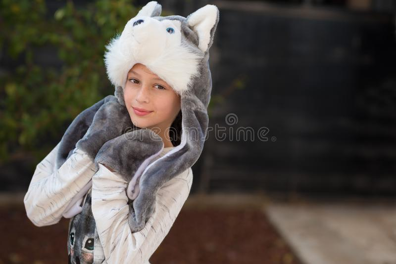 Outdoor close up portrait of young beautiful happy smiling teen in in carnival costume. royalty free stock photo