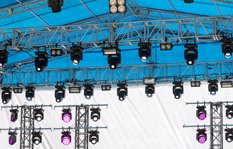 Outdoor concert stage with lighting equipment before concert. Outdoor concert stage with lighting equipment before performance stock photo