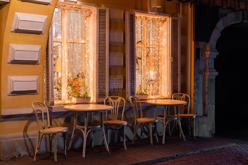 Outdoor cozy summer cafe in the evening.  royalty free stock photos