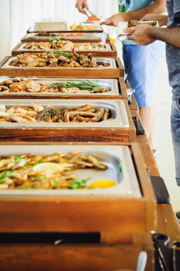 Outdoor Cuisine Culinary Buffet Dinner Catering. Group of people in all you can eat. Dining Food Celebration Party Concept. Servic stock photography