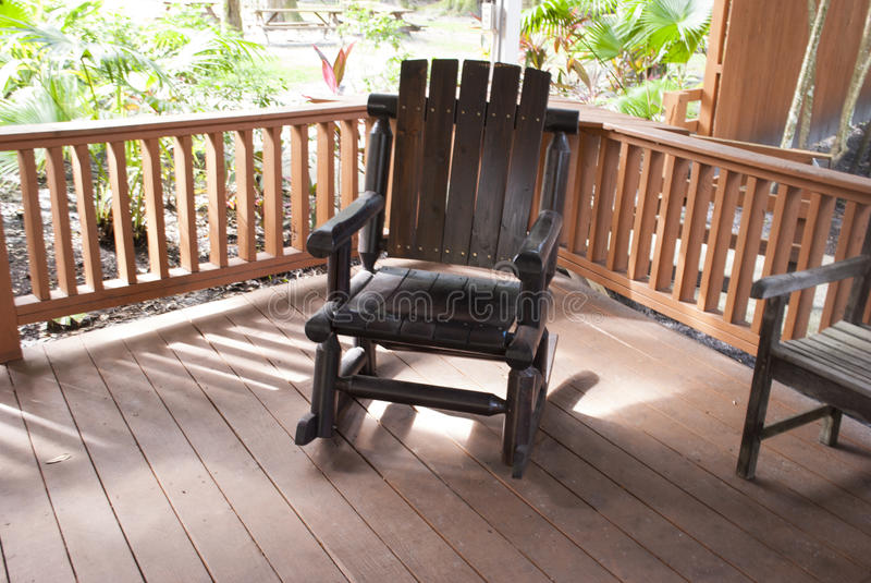 Admirable Outdoor Dark Wooden Rocking Chair In The Garden Stock Photo Gmtry Best Dining Table And Chair Ideas Images Gmtryco