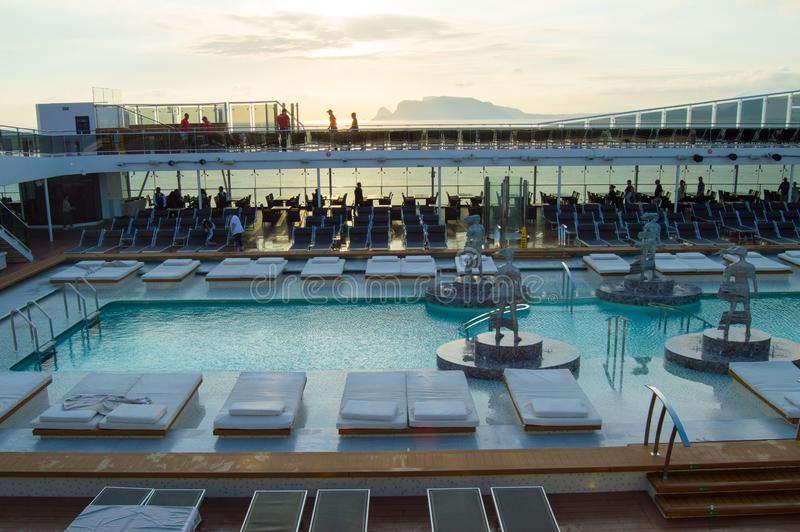 Outdoor deck with swimming pool, sun beds, video screen. CRUISE ship MSC Meraviglia, 8 October 2018 stock images