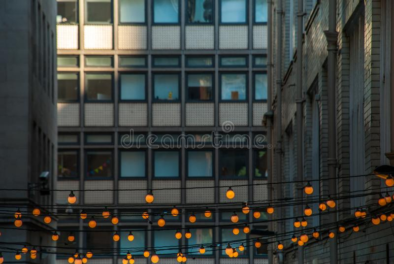 Outdoor decorative string lights hanging in front of the building in the evening. Suitable for background images royalty free stock photography