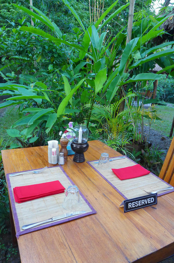 Reserved table, Outdoor dining, tropical resort stock photos