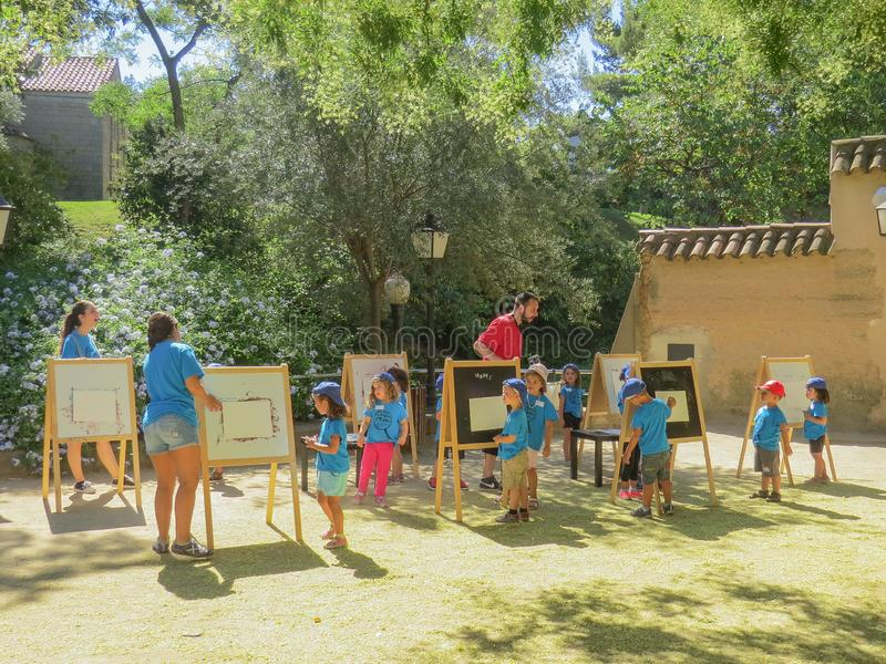 An outdoor drawing lesson for a group of children from three to six years old. Spanish village. Park Museum. Barcelona, Spain, July 23, 2014. An outdoor drawing royalty free stock images