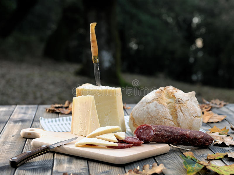 Download Outdoor Eating With Bread, Cheese And Sausage. Stock Photo - Image: 83715248