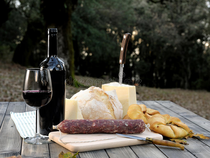 Download Outdoor Eating With Bread, Cheese, Sausage And Red Wine. Stock Photo - Image: 83713931