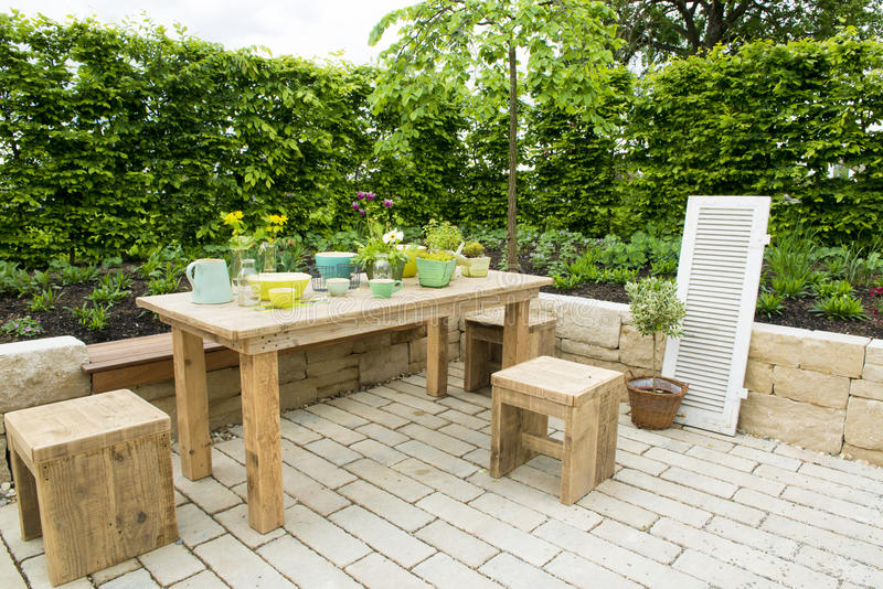 Dining table on patio stock photo