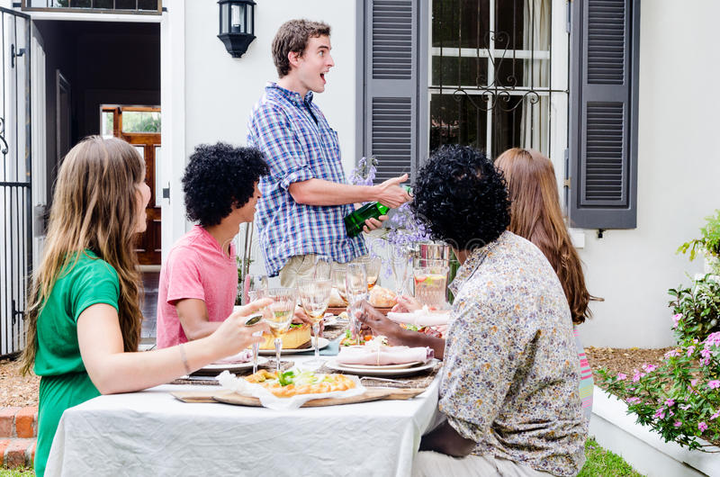 Outdoor entertaining with champagne and food stock images