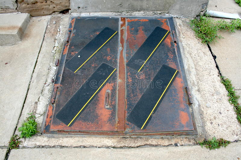 Outdoor exterior rusted doors to stairs to basement floor for Exterior basement access doors
