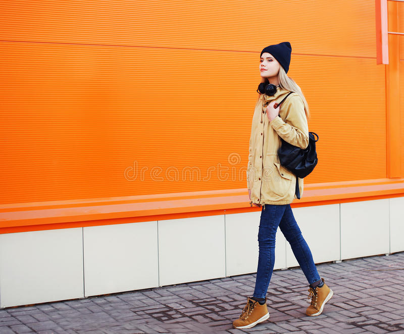 Outdoor fashion photo of stylish hipster cool girl walking stock images